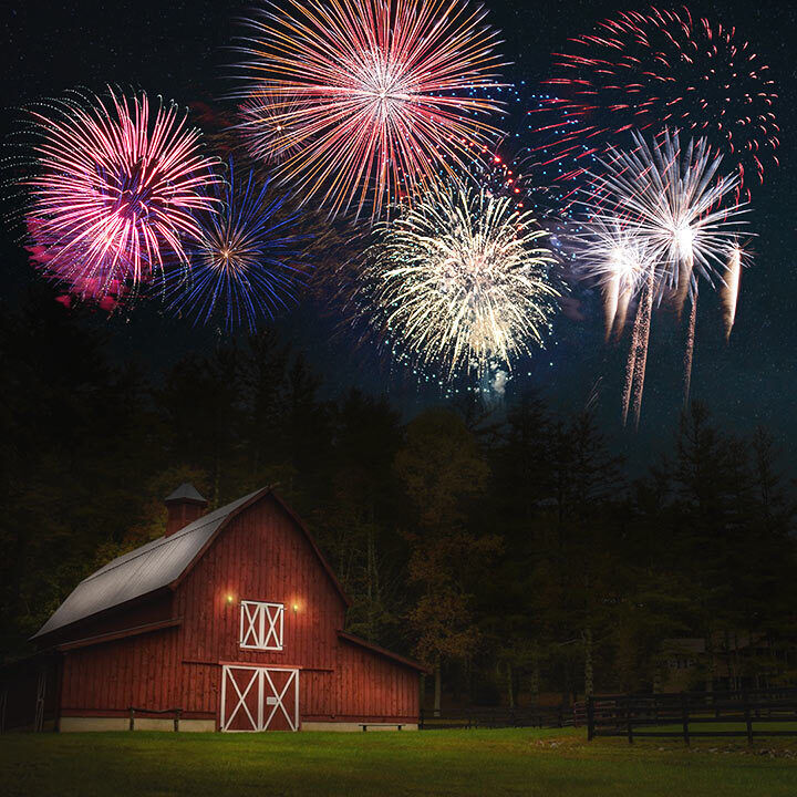 Fireworks over a red barn